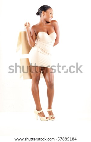 Cute African American and shopping bags - stock photo