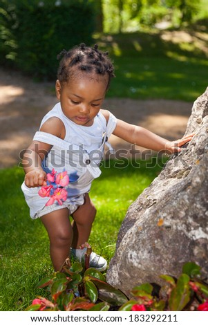 Cute african american baby boy at park - stock photo