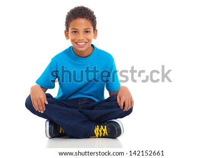 cute african american boy sitting on white background - stock photo