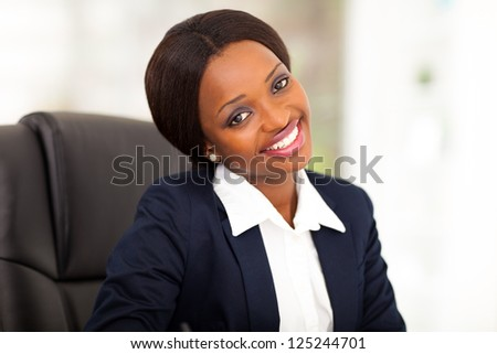cute african american corporate worker in office - stock photo