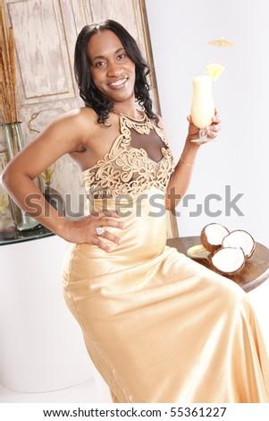 Cute african-american enjoying a pina colada cocktail - stock photo