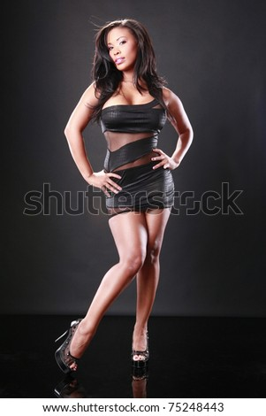 Cute African-American in a sexy little black dress - stock photo