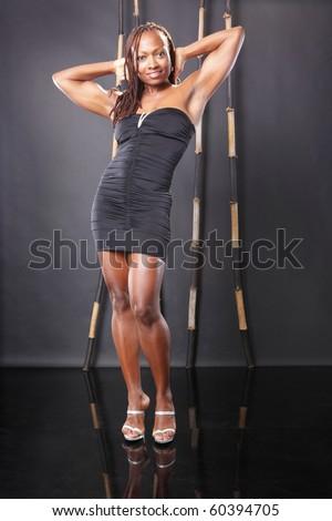 Cute african american in little black dress - stock photo