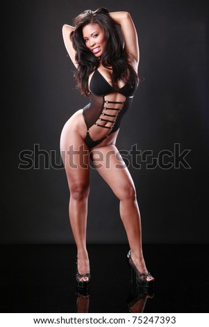 Cute African-American in revealing swimsuit - stock photo