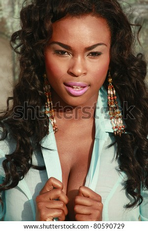 Cute African American in turquoise blouse - stock photo