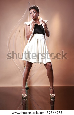 Cute African American in white and black outfit - stock photo