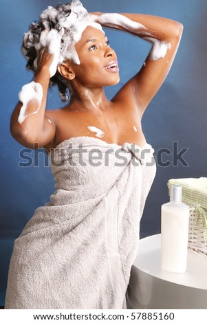 Cute African American using shampoo - stock photo