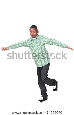 Cute african boy balancing on one leg - stock photo