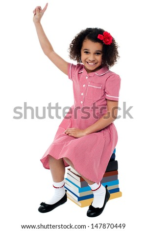 Cute african kid raising her arm up