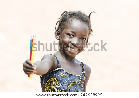 Cute African Little Girl Showing Color Pencils for School Symbol (Isolated Background) - stock photo
