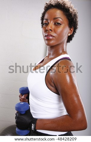 Cute afro-american and her workout routine - stock photo