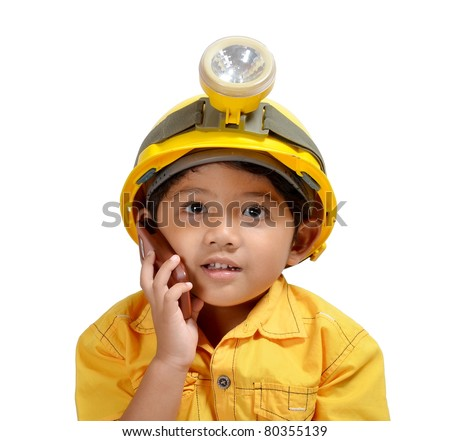 Cute and adorable young asian boy acting as an Engineer