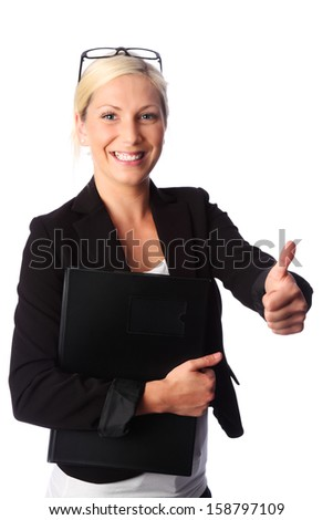 Cute and attractive businesswoman wearing a black suit and glasses, holding a document folder. White background. - stock photo
