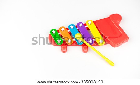 Cute and colourful mini xylophone. 5 note music instrument for children musical education. Isolated on white background. Slightly de-focused and close-up shot. Copy space.