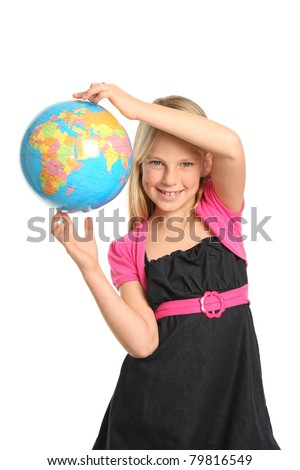 Cute and confident young preteen girl holding the world globe in her fingers - stock photo