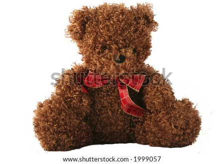 Cute and cuddly teddy bear with a Christmas bow - stock photo