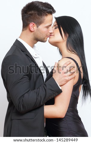 Cute and elegant couple kissing each other - stock photo