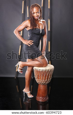Cute and fit black girl with drum - stock photo