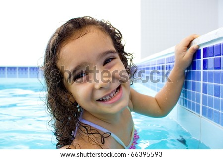 Cute and happy child in the pool .
