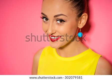 Cute and lovely. Close up colorful studio portrait of pretty young woman is smiling. Pink background. - stock photo