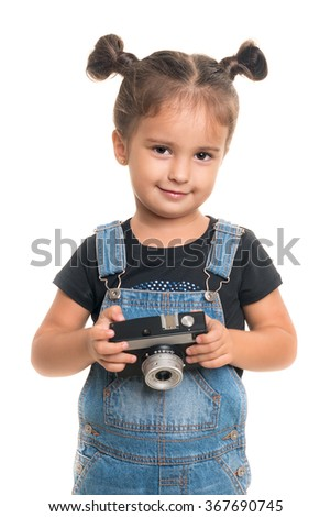 Cute and stylish baby girl  with vintage camera  posing in studio.Isolated - stock photo