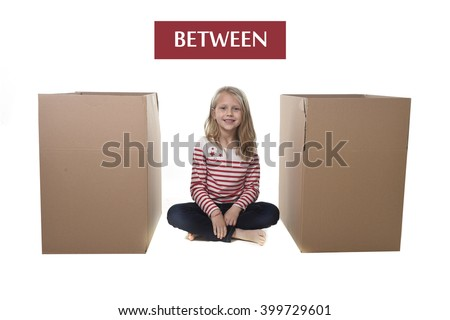 cute and sweet blond hair child sitting between two cardboard boxes isolated on white background  in learning English prepositions and words language card set for education school textbook - stock photo
