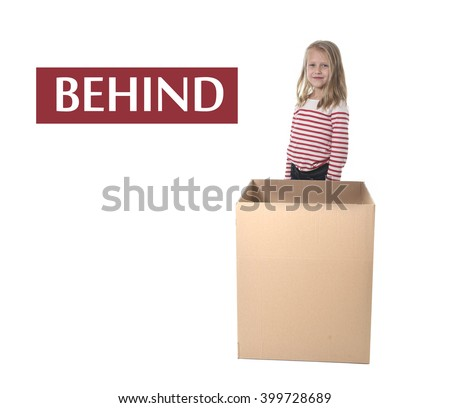 cute and sweet blond hair child standing behind cardboard box isolated on white background in learning english prepositions and words language card set for education school textbook - stock photo