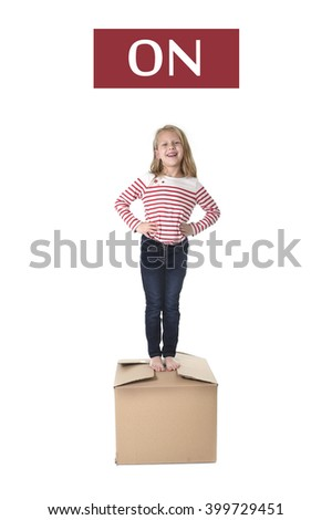 cute and sweet blond hair child standing on top of cardboard box isolated on white background  in learning english prepositions and words language card set for education school textbook  - stock photo