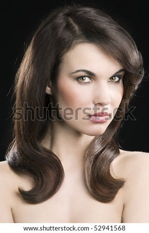 cute and young brunette in a beauty shot with hair stylish looking in camera - stock photo