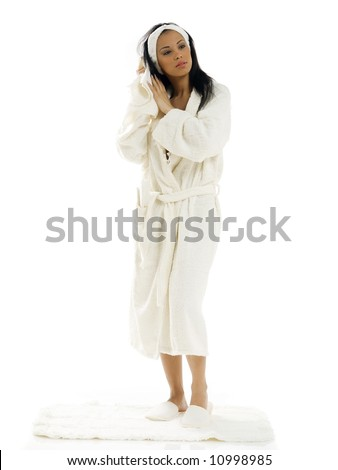 cute and young girl in white bathrobe drying her black hair