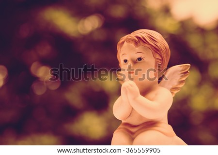 Cute angelic cupid statue valentine day - Vintage style picture - stock photo
