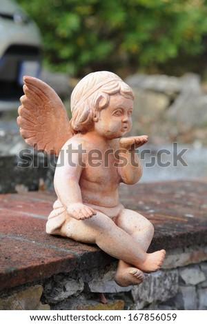 Cute angelic statue - stock photo