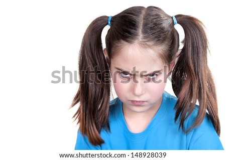 cute angry girl with grimace - stock photo