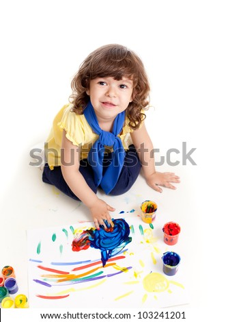 Cute artist kid drawing and painting. Top view of girl.