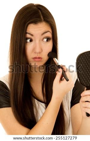 Cute Asian American teen applying blush mirror - stock photo