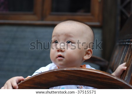 Cute asian baby boy in park