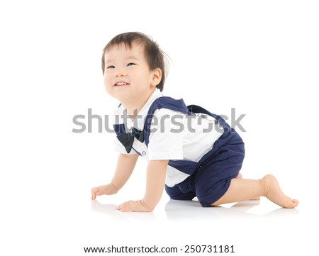 Cute asian baby crawl on  the floor - stock photo