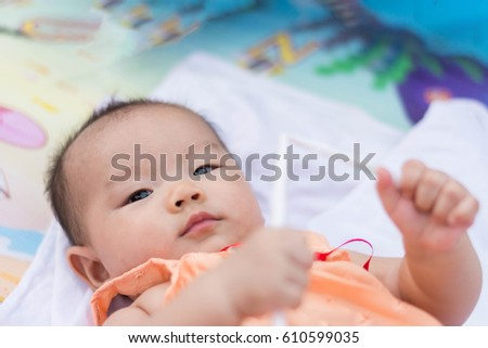 cute Asian baby enjoy playing toy at park