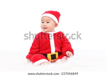 cute asian baby in Santa Claus clothes isolate on white background