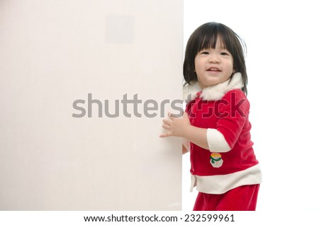 Cute asian baby in santa costume with whiteboard onwhite back ground isolated