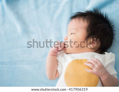 Cute asian baby newborn close up - stock photo