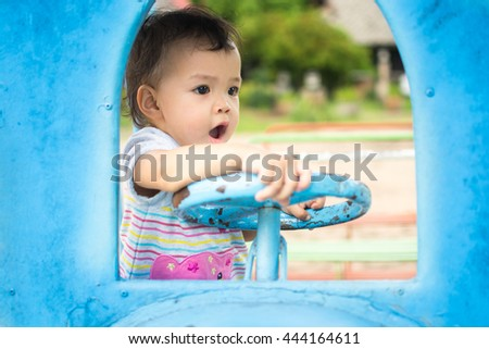 Cute asian baby play in toy car of train, play ground - stock photo
