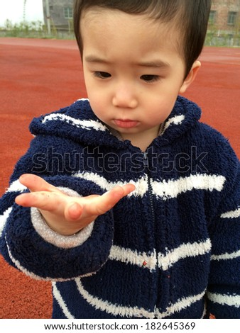 Cute Asian baby playing in the stadium