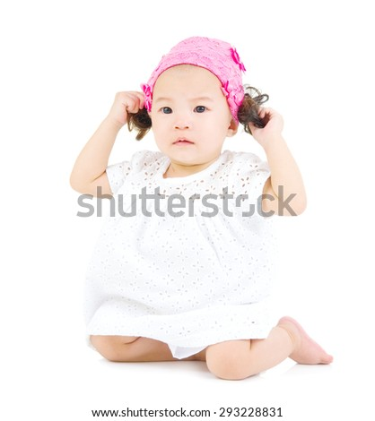 cute asian baby sitting on the floor. - stock photo