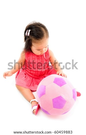 Cute Asian baby with a plush ball . - stock photo