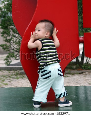Cute Asian boy at the playground - stock photo
