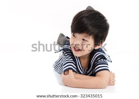 Cute asian boy in sailor uniform lying on white background isolated - stock photo