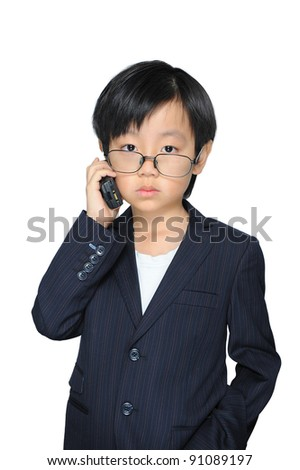 Cute Asian boy in suit making phone call