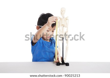 Cute Asian boy learns about human anatomy isolated on white