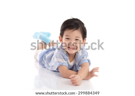 Cute asian boy lying on white background isolated - stock photo